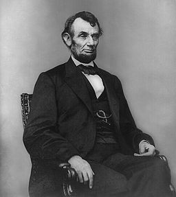256px-Abraham_Lincoln_seated,_Feb_9,_1864